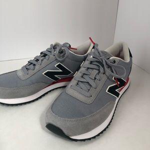 Gray and rednew balance sneaker. Brand new